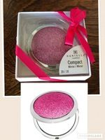 Pink Glitter Compact Mirror by Danielle Creations. Brand new and still in box. Never opened. This compact features a double-sided mirror that's perfect for touch-ups. RV$13