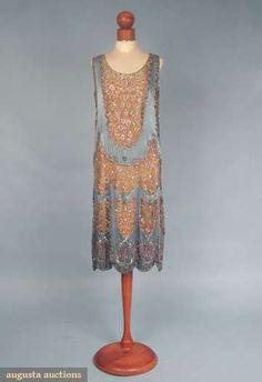 mid 1920s dress, Blue silk satin w/ scallop shaped inserts of gold lace trimmed w/ crystal bugle beads, small crystal & pink beads, diamante & small silver sequins, scalloped hem, beaded butterflies above scallops, peach silk slip, augusta-auction.com