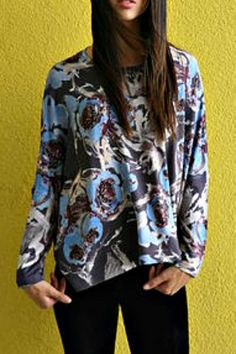 This knit top has 3/4 dolman sleeves which give it a relaxed loose fit. The fabric is very soft and stretchy in a floral abstract print. Very denim friendly!   Abstract Floral Top by Inoah. Clothing - Tops - Long Sleeve California
