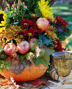 Autumn Tablescape / Thanksgiving Table / Fall Decor / - Flowers and Apples in a pumpkin  centerpiece