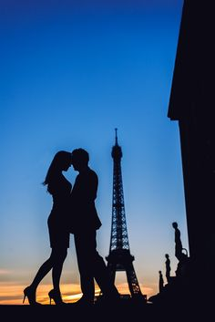 When you are in love you can't fall asleep because reality is better than your dreams.   Silhouette picture captured at sunrise of a couple celebrating their babymoon in Paris, by Paris Photographer Fran Boloni