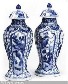 KANGXI DYNASTY - Chinese blue and white vases and associated covers, (2)