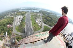 James Kingston climbed 380 feet to the top of the bridge along with his friend to perform the stunt