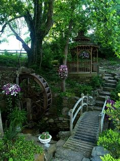1b: In the fairytale section of her backyard, she has a gazebo outside for when the weather is drizzly or rainy. It's like a small woodland fairy house with a small river and bridge surrounding it.
