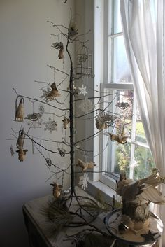 I like the wire tree. It would be fun for Christmas, but could be decorated in a variety of ways throughout the year. Antique Christmas, Noel Christmas, Primitive Christmas, Country Christmas, All Things Christmas, White Christmas, Christmas Crafts, Christmas Decorations, Christmas Ornaments