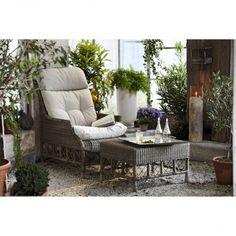 Lounge-Sessel mit Kissen