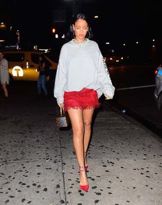 Rihanna pairs a sweatshirt with heels and a mini for the perfect night out look.