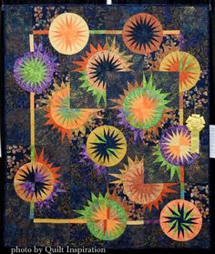 Total Eclipse by Hope Adams, quilted by Diane Tricka (2015 Arizona Quilters Guild show).  Pattern by Judy Niemeyer. Photo by Quilt Inspiration.
