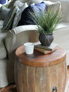 side table with books to lift plant and small cup by hfreemandesign.com