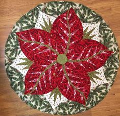 Poinsettia, Quiltworx.com, Made by  Becky Batchelder Forbes,Taught by CI Catherine Wilson Table Topper Patterns, Table Toppers, Christmas Gifts, Christmas Decorations, Holiday Decor, Foundation Paper Piecing, Square Quilt, Poinsettia, Fabric Design