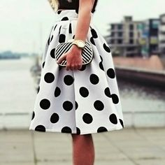 Pleated Polka Dot Circle Skirt  Elegant polka dot skirt features pleated at waist, side zipper, blank polka dots on white fabric. Cotton blend material. Knee length. Boutique Skirts Midi