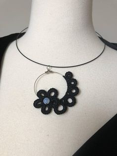 Beautiful tatted lace pendant , frivolite , handmade knotted lace , tatted jewelry , vintage. This posting is for the pendant only. Necklace not included. This beautiful delicate pendant is unique. It will stand out with your favorite black dress or just a plain tee-shirt. Tatting is a