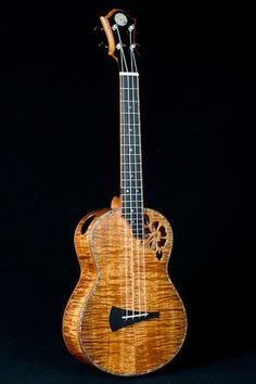 DeVine Guitars, Master koa ukulele with koa bindings and a flower-shaped soundhole.