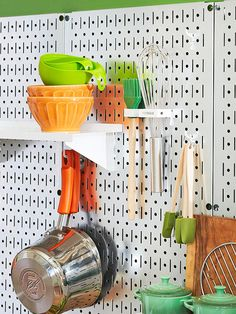 Simple Solution for small apartment, use a metal peg board & custom fit your pots, pans & even shelves.  Great idea if you could custom fit to hang over a pantry door