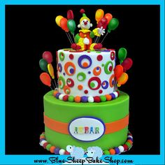 Green with Orange Band and Green, Blue, Orange & Red Dots & Circles Circus Birthday Cake with Clown & Balloons Topper (Akbar)