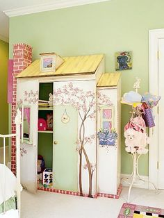 cutest wardrobe / storage ever. Great for a fairy garden girls' bedroom | Try with regular cabinet, but build a roof and paint it to look like a house.  And/or add window boxes.