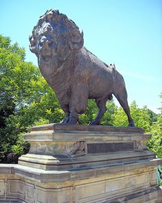 Buffalo statue at Dumbarton Bridge separating Dupont Circle and Georgetown in Washington, D.C. The bridge is listed on the National Register of Historic Places.