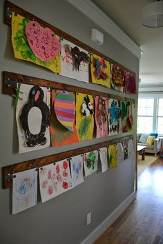 Great way to hang kids art magnets distressed wood preschool display paintings memo wall art gallery command center Hanging Kids Artwork, Displaying Childrens Artwork, Artwork Display, Display Wall, Art Wall For Kids, Display Kids Art, Preschool Art Display, Childrens Art Display, Kid Art Displays