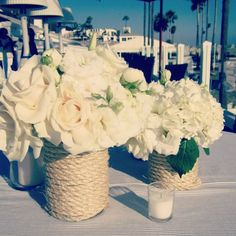We could get cheap vases in whatever color and wrap rope around them! Super gorgeous and nautical.