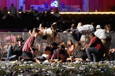 People scramble for shelter at the Route 91 Harvest country music festival after apparent gun fire was heard on Oct. 1, 2017 in Las Vegas. (Photo: David Becker/Getty Images)
