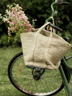 an old vintage bike with a basket of flowers...