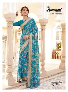 Teal blue color georgette fabric,floral print, satin patty & chikan embroidery work blouse are all equal playing important role in this attire. #Laxmipati #Sarees
