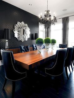 wallpaper, silver starburst mirror and leather chairs with nailheads bring the glam