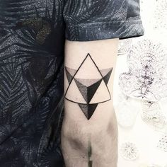 Merkabah tattoo on the back of the right arm.