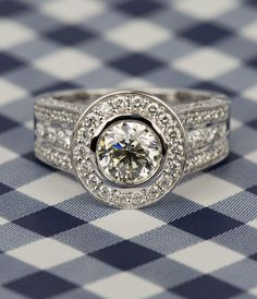 Our Halo Bezel Diamond Engagement Ring in White Gold! Click to see more of our recently purchased rings.