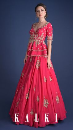 #ThePowerOfPeplum Add a girly pop of color to your ethnic wardrobe with this ruby pink peplum lehenga which also features a deep plunge neckline highlighted in hand-embroidered floral motifs. Perfect for the next wedding you attend! Go grab💕