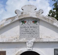 """Atop the Roberts family crypt is the grave marker of Gloria Russell, noting """"I'm just resting my eyes."""""""