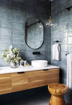 A harmonious balance between timber vanity, white benchtop and basin, black hardware and those beautiful blue glazed rustic tiles. | designed by Studio Black Interiors | �Iris Aguamarina� wall tiles from Rivoland Tiles