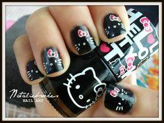 Hello Kitty nails! Black and white with pink bows #nails DIY NAIL ART DESIGNS