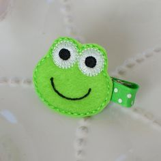 Brighten up your look with an electric-green froggy hair clip!