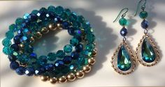 In this striking set, Bermuda blue-green Swarovski crystal drop earrings are Fall's must- have for your jean outfits and on into evening wear~