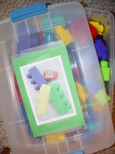 Use pictures on organizational containers to help toddlers put away their toys.  (I would add the toy name as well).  This is a fun website, they have some good ideas.