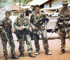 American Green Berets with a variety of interesting equipment, including a shortened M16A1 with an underbarrel grenade launcher and an FN FAL/grenade launcher combination.