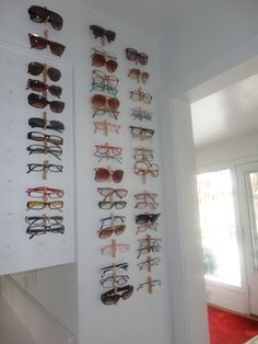 Organize your glasses with clothing pins on the wall. This might only work for you if you are really tall...#glasses Tips by VisAcuity.com