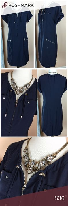 "Chico's Zenergy Navy Riveted Shirtdress Chico's Zenergy Navy Riveted Shirtdress Deep navy with silver accented zippers & rivet studs Perfect for the beach, golf, shopping or anywhere u want comfort and style☺️  Made of 83% polyester, 13% spandex  Worn once, excellent condition  Chicos Size 0, Reg Size 4 Bust 19"" across, waist 16"" across, 38"" long  ‼️PRICE FIRM UNLESS BUNDLED‼️ Create a bundle for 15% off! Thanks for looking✌️❌NO TRADES❌ Chico's Dresses"