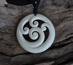 Handcarved in Bone. Renewal Koru with trinity by JackieTump, $160.00