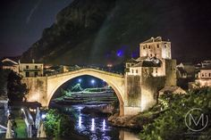 Night lights surrounding the Old Bridge in Mostar, Bosnia and Herzegovina. Visit our website: www.tourguidemostar.com #mostar #tourguidemostar #oldbridge #starimost #bosniaandherzegovina #unesco #worldheritage #architecture #landmark #travel #photography