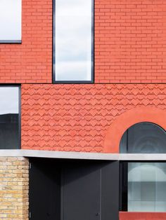 The key difference between the neighbouring properties and the Red House is the new building's entirely red-brick exterior.