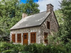 This two-bedroom architectural treasure is a home of historic significance. Built in the home Old Quebec, Montreal Quebec, Stone Cottages, Stone Houses, Stone Cabin, Cottages And Bungalows, Montreal Ville, Wood Windows, Old Houses
