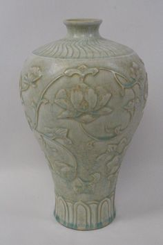 A fine Chinese Song style celadon porcelain vase carved with flowers in relief