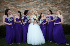 What a beautiful group of women! The Bride poses with her bridal party. All of them are holding color-coordinated pinwheels! We are absolutely in LOVE with them! www.CrystalBallroomNJ.com Photo courtesy of Bella Pictures. #wedding #bride #groom #reception #CrystalBallroom #Radisson #Freehold #NJ #NewJersey #venue #ballroom #njbanquethall