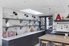 Gray and white London kitchen renovation, skylights, open shelving inspired by French bistros, pantry: Remodelista