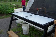 Veggie washing sink made from a 55 gallon plastic barrel.