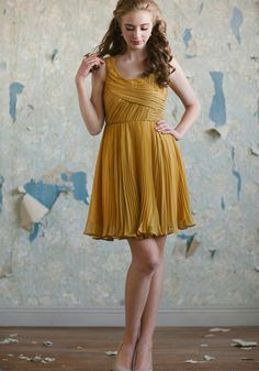 """Forsythia Dress 84.99 at shopruche.com. Perfected in sumptuously soft chiffon, this mustard dress features ruched details for texture and a pleated skirt for graceful movement. A hidden side zipper closure and subtle interior bust cups complete the silhouette.  Self: 100% Polyester, Lining: 95% Polyester, 5% Spandex, Imported, 34"""" length from top of shoulders, Model is 5'8"""", All measurements taken from a size small"""