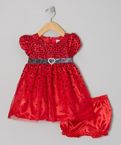 Dressing to the nines will be quite the fuss-free affair when this fancy puff-sleeve frock is invited to the party. Aside from the shimmering spotted pattern, it also boasts a bitty heart accent and handy-dandy zipper in the back. Note: Only infant sizes include bloomers.