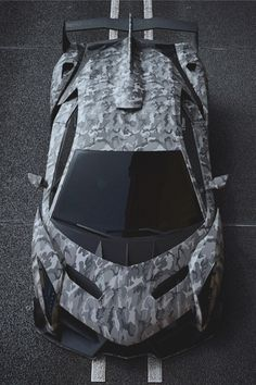 Land shark…kind of crackin' me up.  carbonandfiber:  Camo Lamborghini Veneno